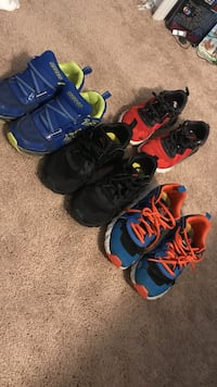 Four assorted-color pair of basketball shoes