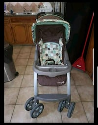 baby's black and gray stroller Montréal, H8N 1W2