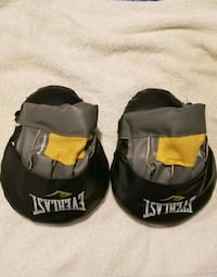 pair of black-and-yellow boxing mitts.