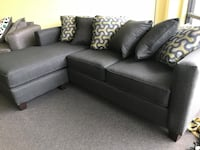 black leather sectional sofa with throw pillows 335 mi