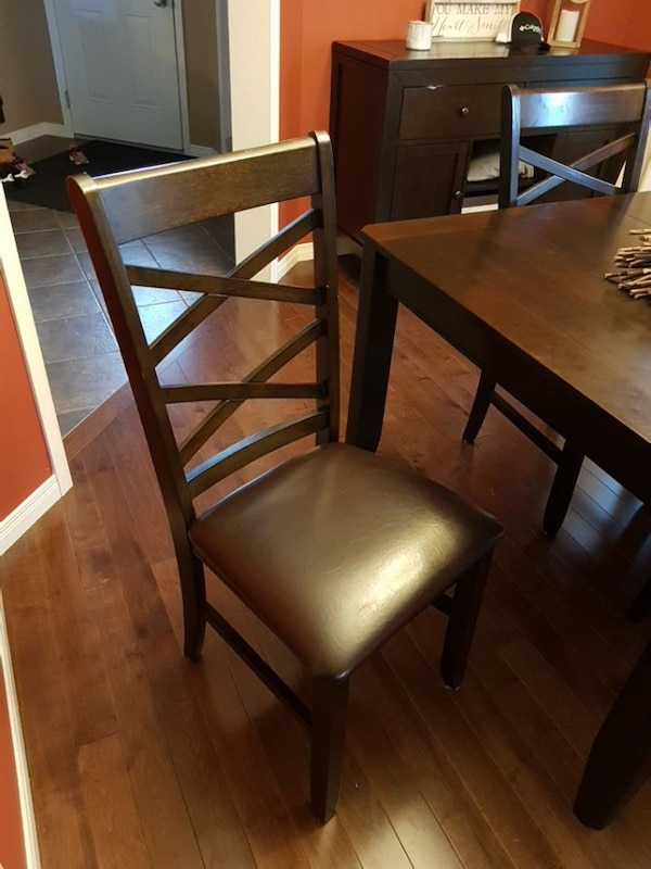 Selling 4 Brown Leather Dining Room Chairs