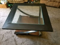 rectangular black wooden framed glass top coffee table