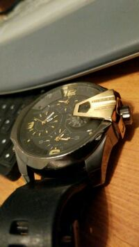 round black chronograph watch with black leather strap Calgary, T2T 0H9
