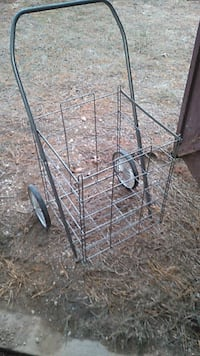 two gray metal clothes racks 292 mi