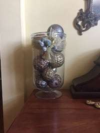 """Christmas footed glass container with silver, gold, copper glitter balls & gold ribbon with silver balls outside on top, 12"""" tall"""