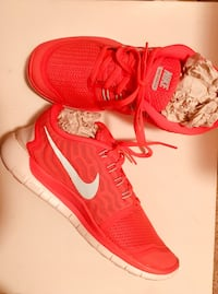 pair of red Nike running shoes Fairfax, 22031