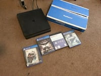 black Sony PS4 console with game cases Bakersfield, 93301