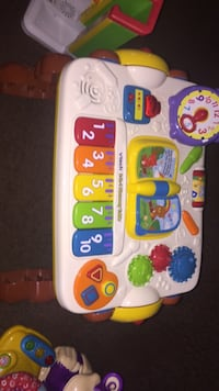 white and multicolored Vtech learning toy 468 mi