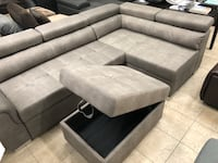 Free delivery grey sectional with pull out bed Guelph, N1E 1B3