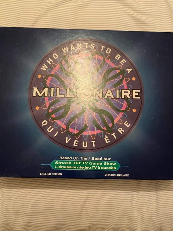 Who Wants to be a Millionaire Board Game 94aa2209-0690-4395-9854-a2e44529df60