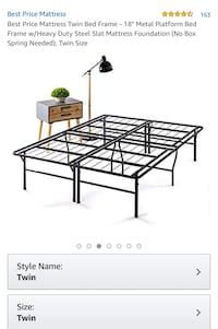 A pair of twin size bed frame of metal