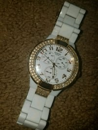 round silver chronograph watch with white link bracelet