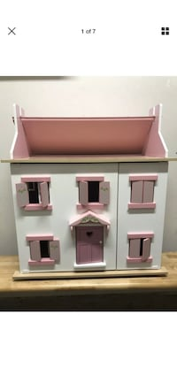 Large Wooden play doll house. Looks small in picture