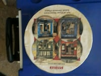 The sakura table set of 4 plates depicting storefronts
