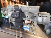 Smoke Hollow Pro series grill in great working condition! Use it with propane gas or use it as a charcoal grill or use the smoker firebox for indirect cooking and authentic BBQ smoke flavor or use the searing burner. Four grilling options in one unit! Cha 1078 mi