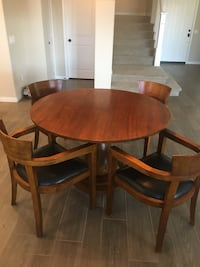 round brown wooden table with four chairs dining set Ventura, 93003
