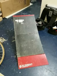 Black and red Element skateboard ramp