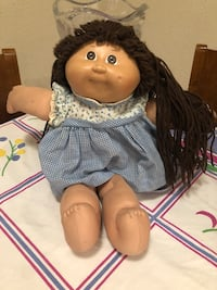 Vintage 1982 Cabbage Patch Doll. Comes with original dress, birth certificate, receipt.  Jacksonville, 32217