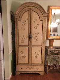 Large TV armoire with painted floral design 31 km