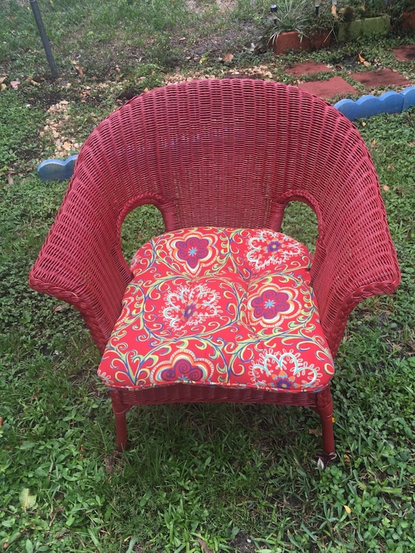 red and brown floral padded chair