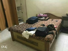 brown wooden bed