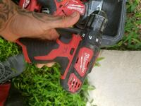 red and black Milwaukee cordless power drill Clifton, 07013