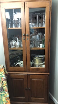 Brown wooden framed glass display cabinet Northville, 48168
