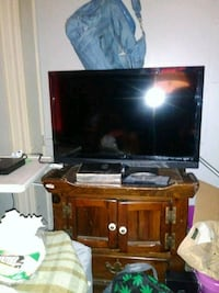 flat screen television with brown wooden TV stand Hanover, 17331