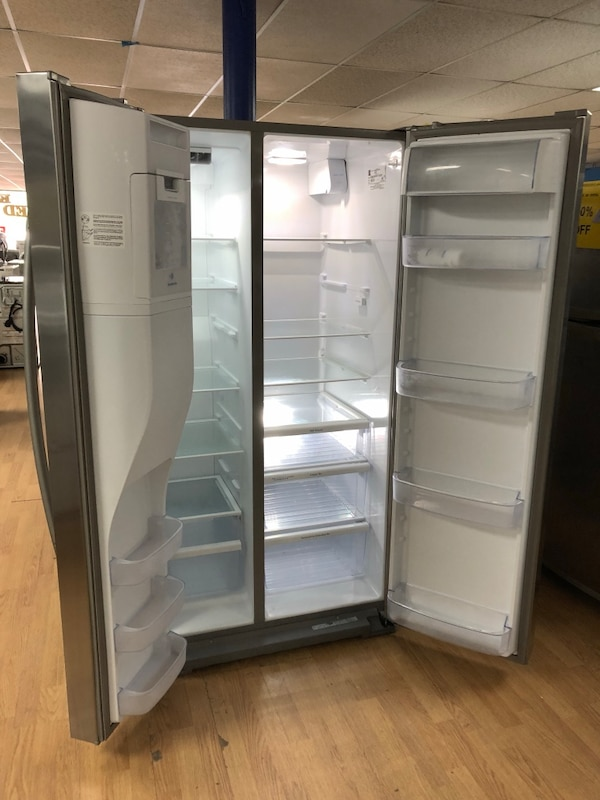 Kenmore stainless steel side by side refrigerator  1