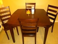 rectangular brown wooden table with six chairs dining set Fayetteville, 28314