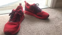 pair of red Nike running shoes Clermont, 34711