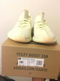 Pair of white adidas yeezy boost 350 v2 with box