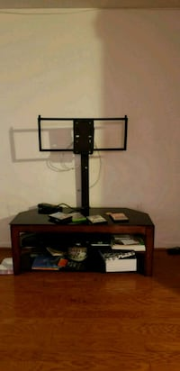 black TV stand with mount 49 km
