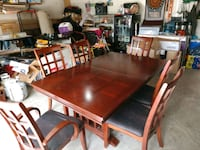 rectangular brown wooden table with six chairs din Houston, 77082