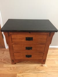 Wood 3-drawer chest with table extension.