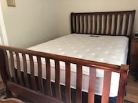Brown wooden sleigh bed frame with white mattress and box spring San Jose, 95124