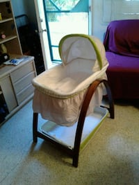 baby's white and brown bassinet