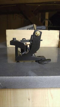 Hand made traditional coil tattoo machine.  Vancouver, V6G 1N1