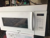 White general electric microwave oven 558 km