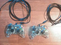two clear Xbox game controllers
