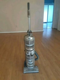 gray and white upright vacuum cleaner 25 km
