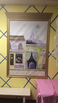 brown wooden framed painting of store