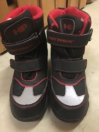 Black red and gray hot paws velcro-strap boots. very gentle used last winter. size 4