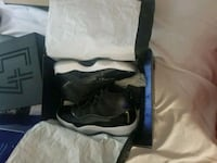 pair of black Air Jordan 11's in box Laredo