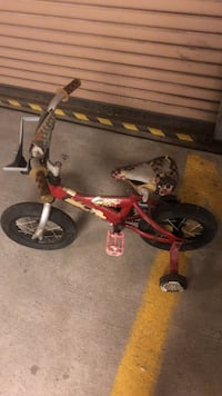toddler's red and white bicycle with training wheels Maplewood, 07040