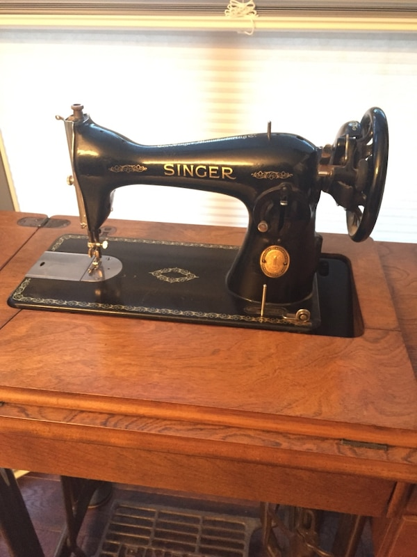 black Singer mechanical sewing machine