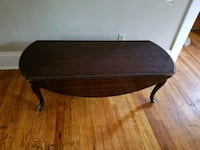 Solid wood coffee table with fold down sides Syracuse