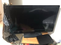 black flat screen TV with remote Edmonton, T6K