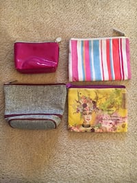 three assorted color leather wallets Edmonton, T6G 2J5