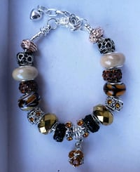 Brown and gold charm bracelet 2 for $25 Baltimore, 21224
